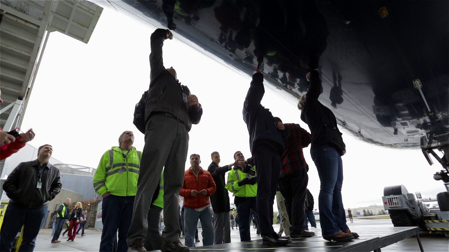 Boeing workers sign the underside of the last Delta Airlines passenger 747.