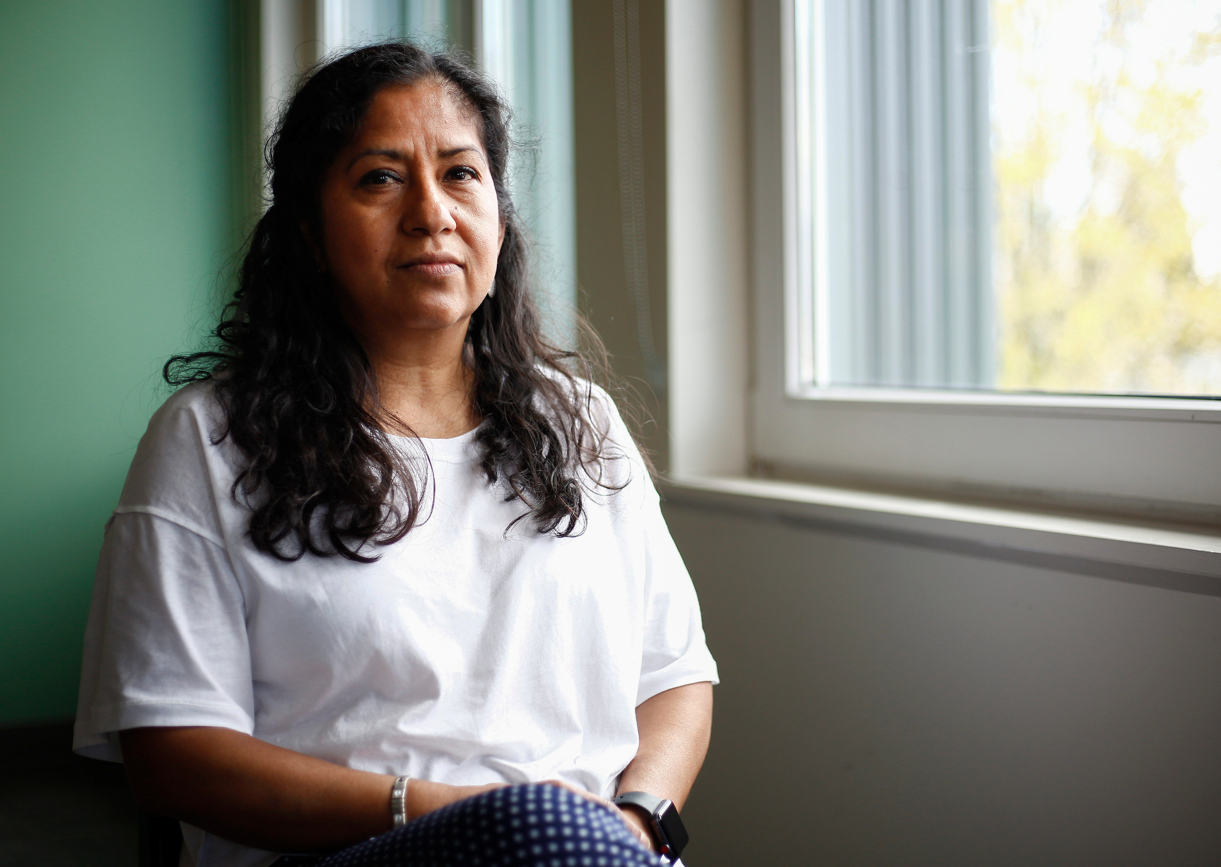 Community organizer and domestic worker Silvia Gonzalez poses for a portrait at Casa Latina in Seattle on Tuesday, April 10, 2018.