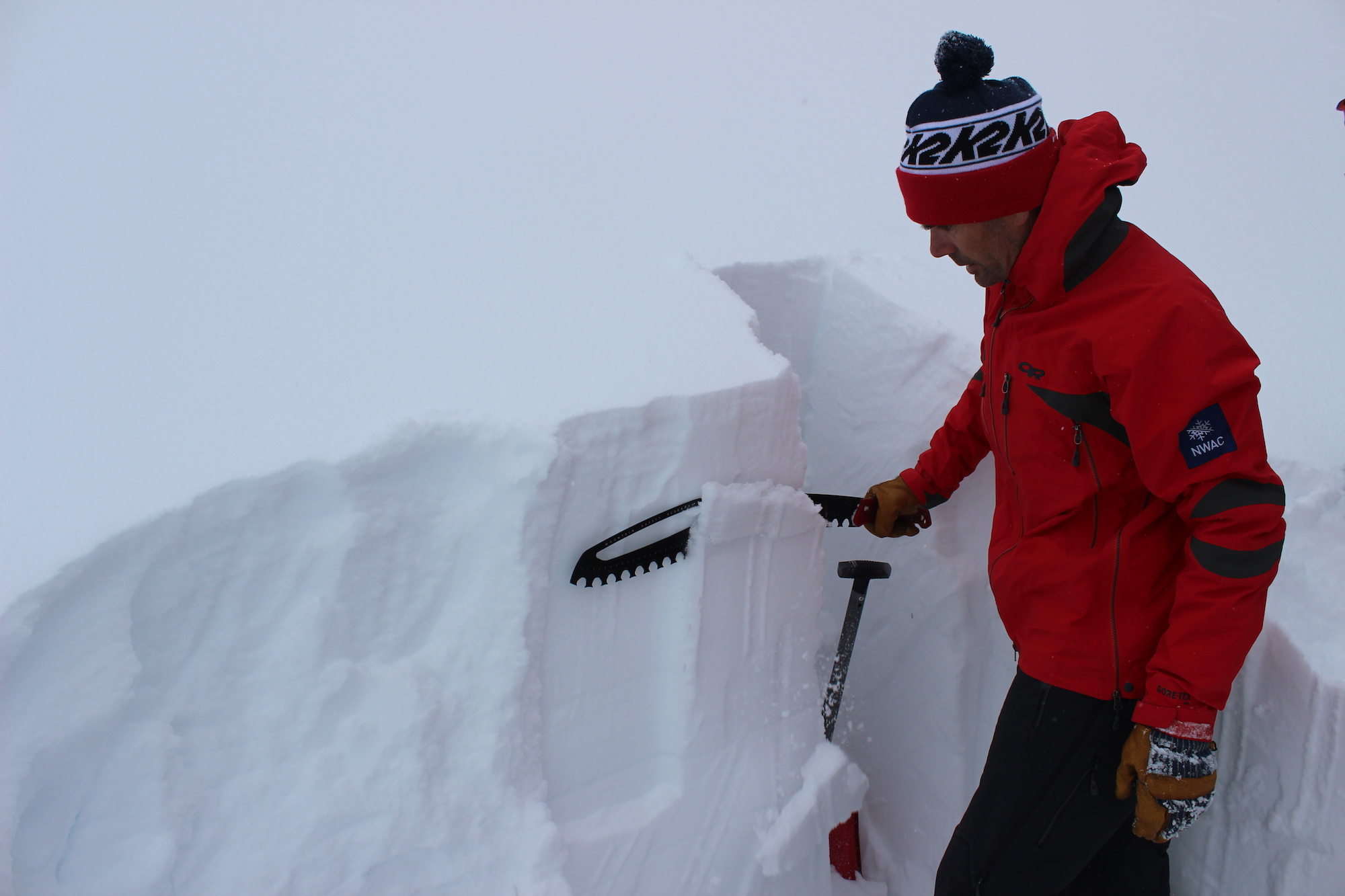 Allyn saws down the snow in a test pit to check for stability.