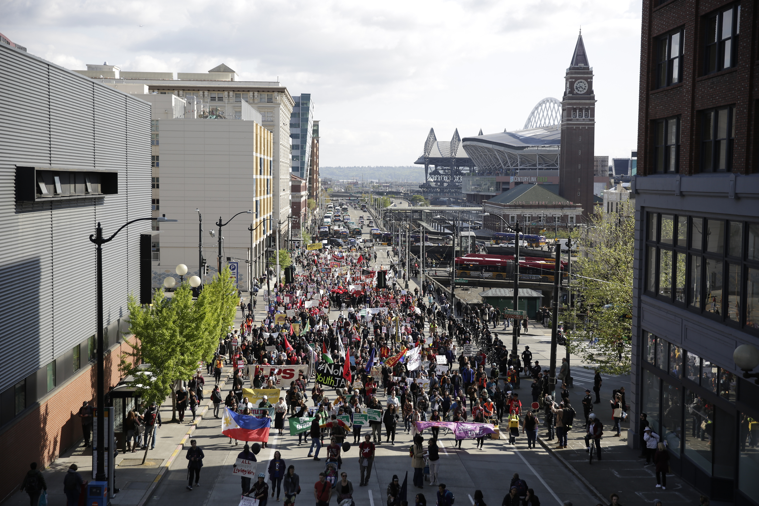 Marchers make their way onto 4th Avenue South from South Jackson Street during the annual May Day March for Workers and Immigrant Rights in Seattle, May 1, 2018.