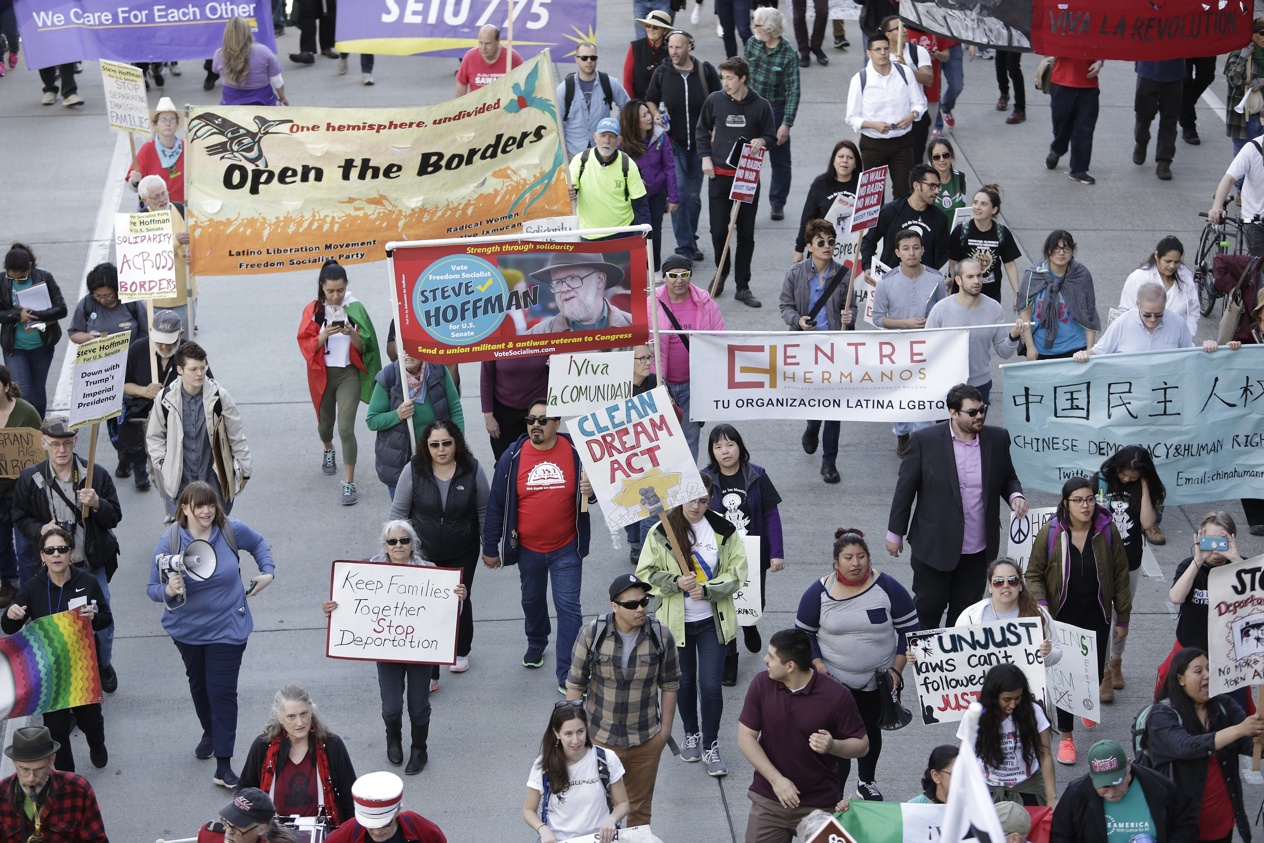 People march down 4th Avenue South during the annual May Day March for Workers and Immigrant Rights in Seattle, May 1, 2018. (Jason Redmond for Crosscut)