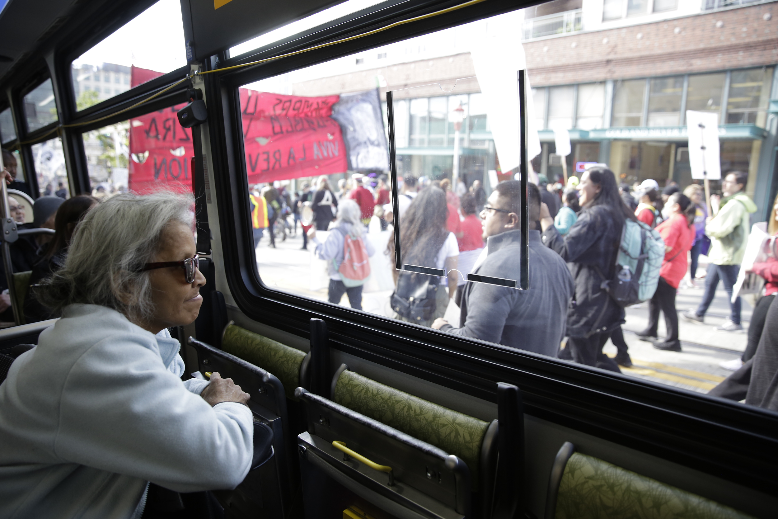 Darlene Hadley of Seattle watches from a bus stuck in traffic on South Jackson Street in the International District during the annual May Day March for Workers and Immigrant Rights in Seattle