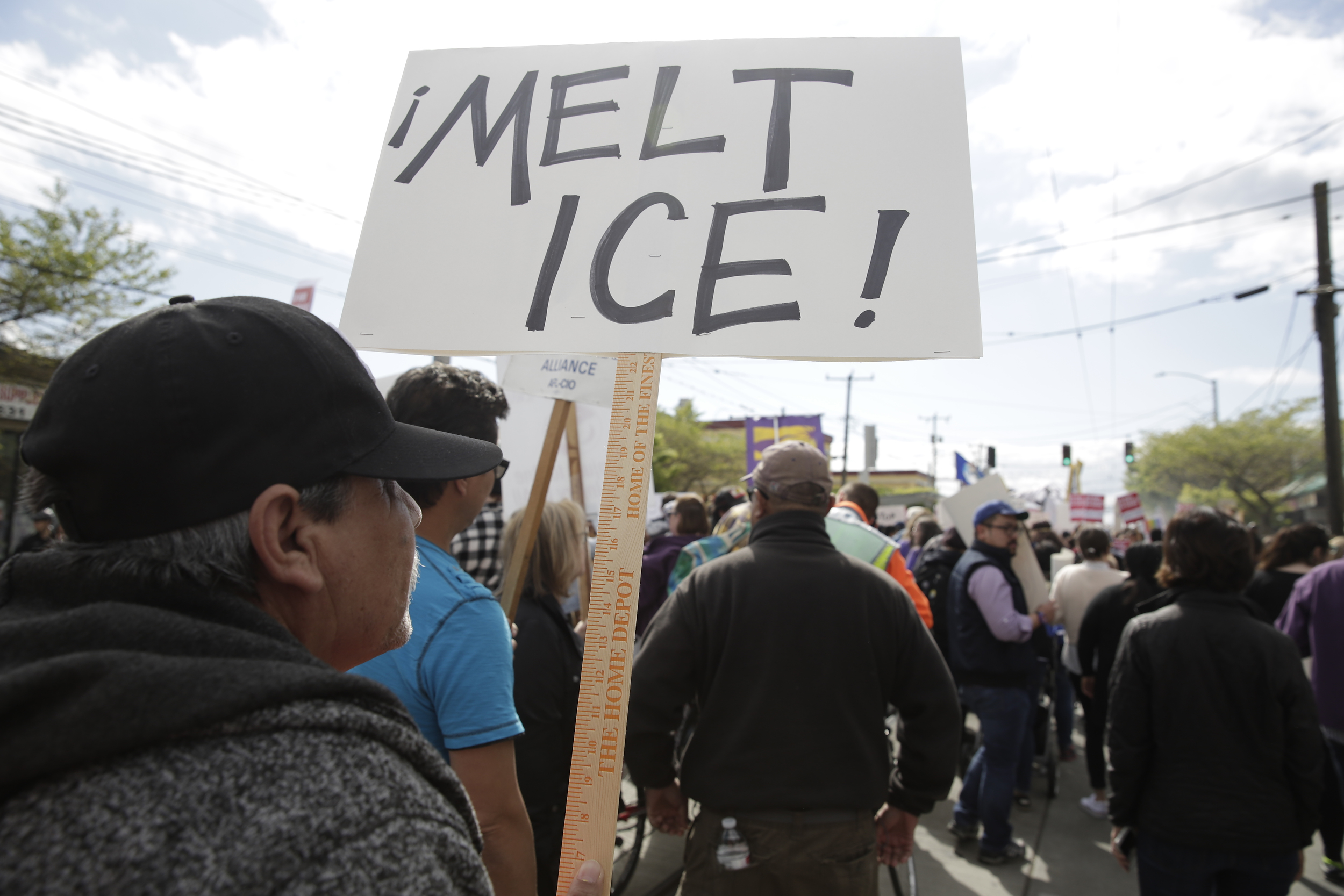 Clemente Rodriguez of Seattle carries sign referring to the Immigration and Customs Enforcement (ICE) sign during the annual May Day March for Workers and Immigrant Rights in Seattle