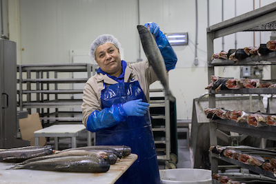 Worker at seafood distributor Ocean Beauty