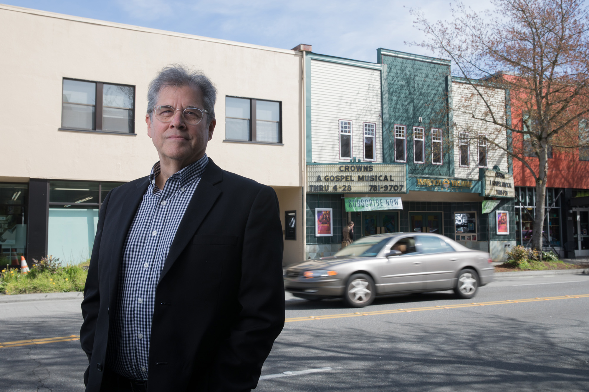 Scott Nolte, president, CEO and producing artistic director of the Taproot Theatre Company, stands for a portrait across the street from the theater off Greenwood Avenue and North 85th Street in Seattle.