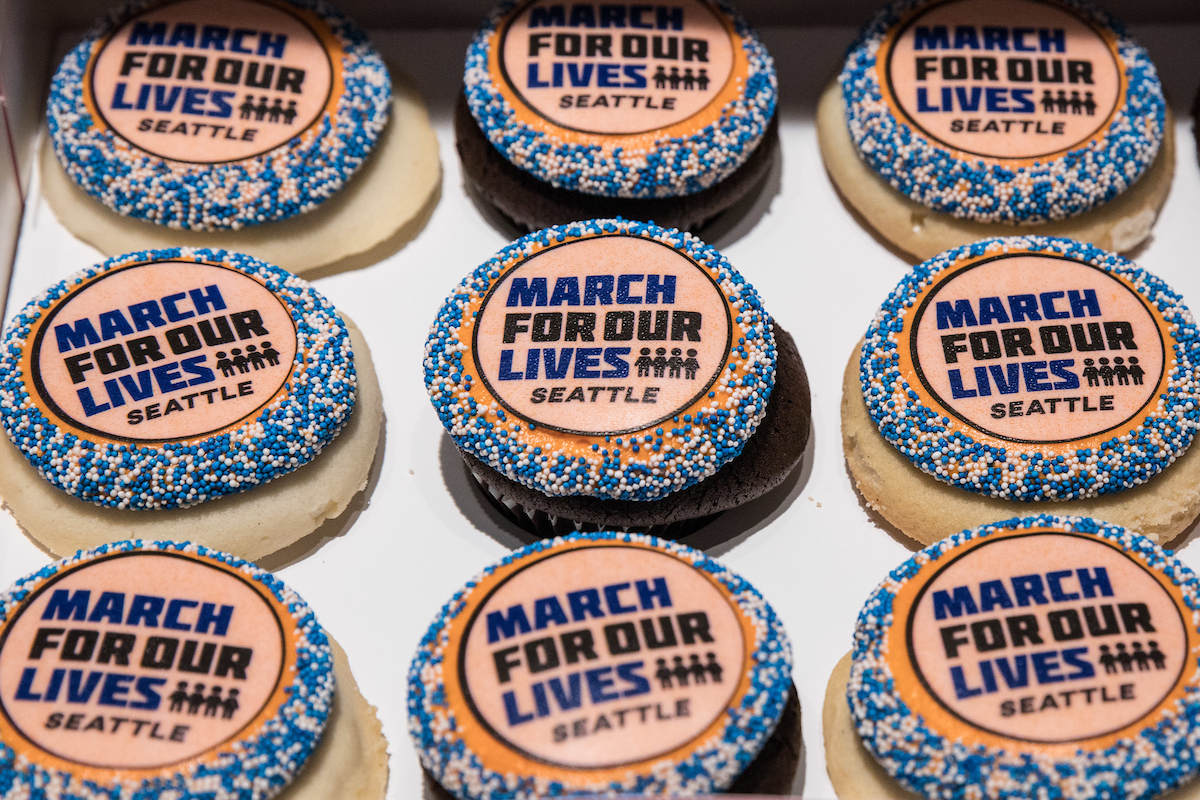 Cupcakes are adorned with the Seattle March For Our Lives logo