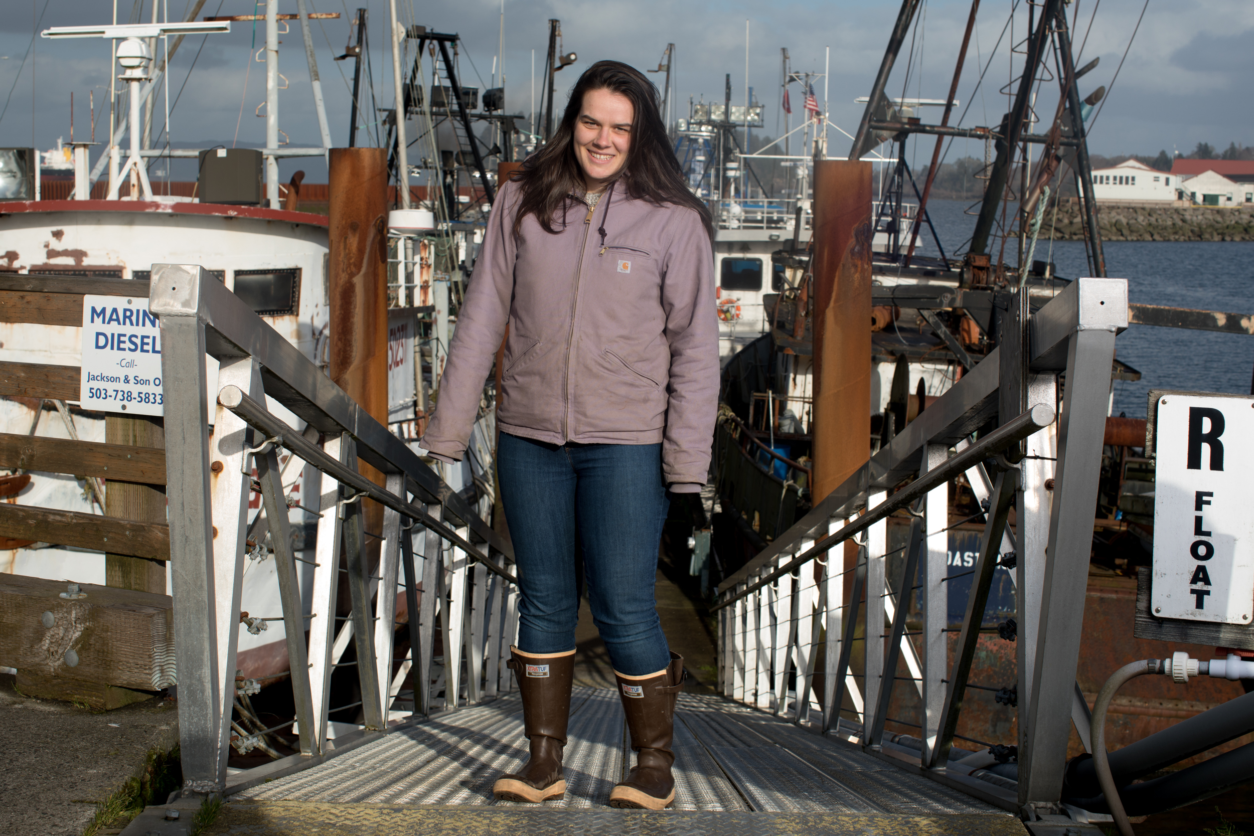 Maggie Bursch of Bellingham, Washington stands for a portrait in the East Mooring Basin of Astoria.