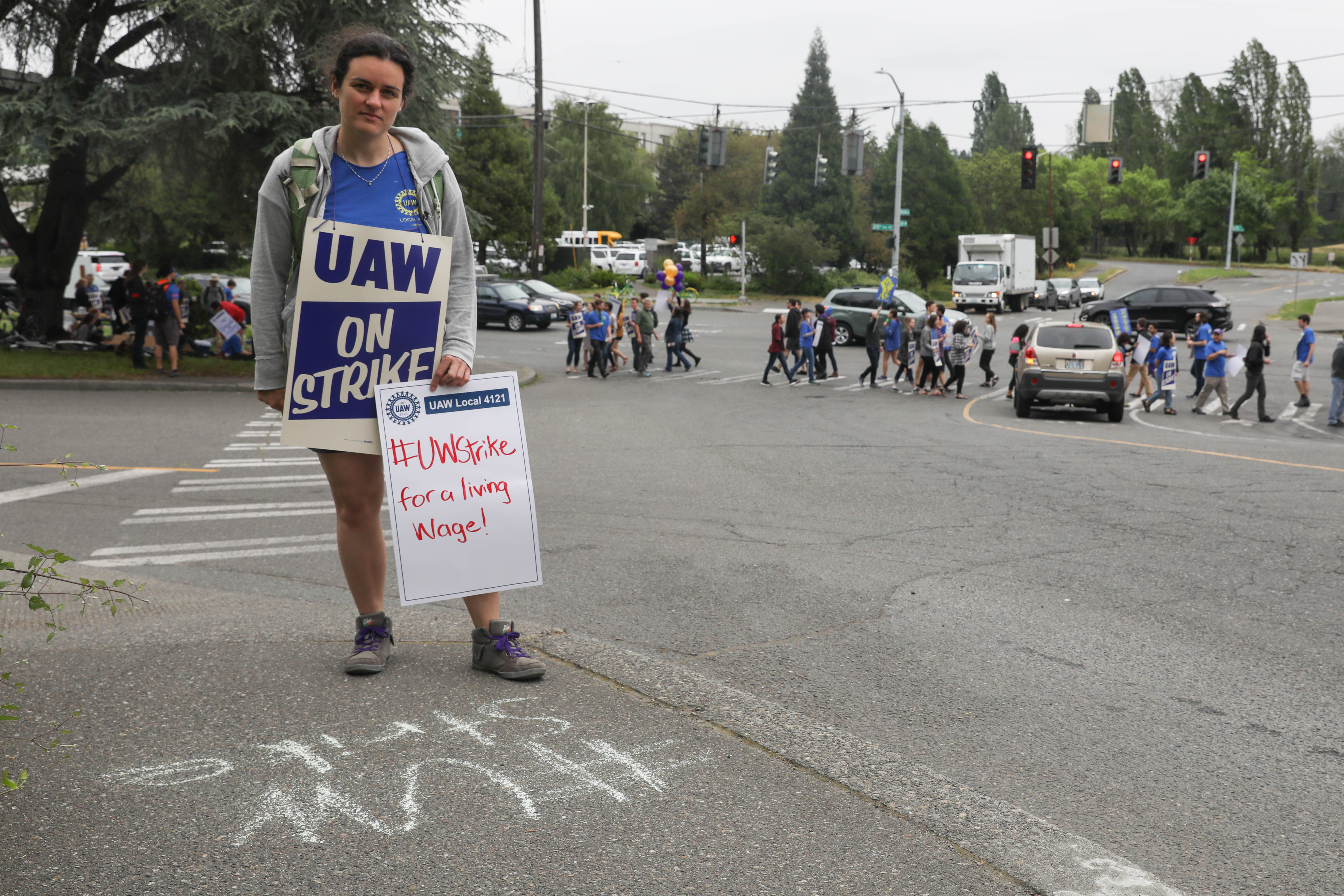 Emily Willard stands near the corner of Pend Oreille Street and Montlake Boulevard NE during a one-day strike with graduate students who are represented by UAW Local 421 at the University of Washington in Seattle, May 14, 2018.