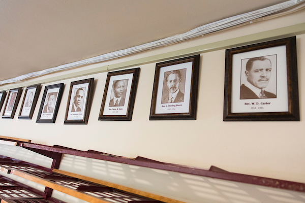 Photos of former pastors hang on the wall at Mount Zion Baptist Church in Seattle on Sunday, May 27, 2018. (Photo by Jason Redmond for Crosscut)