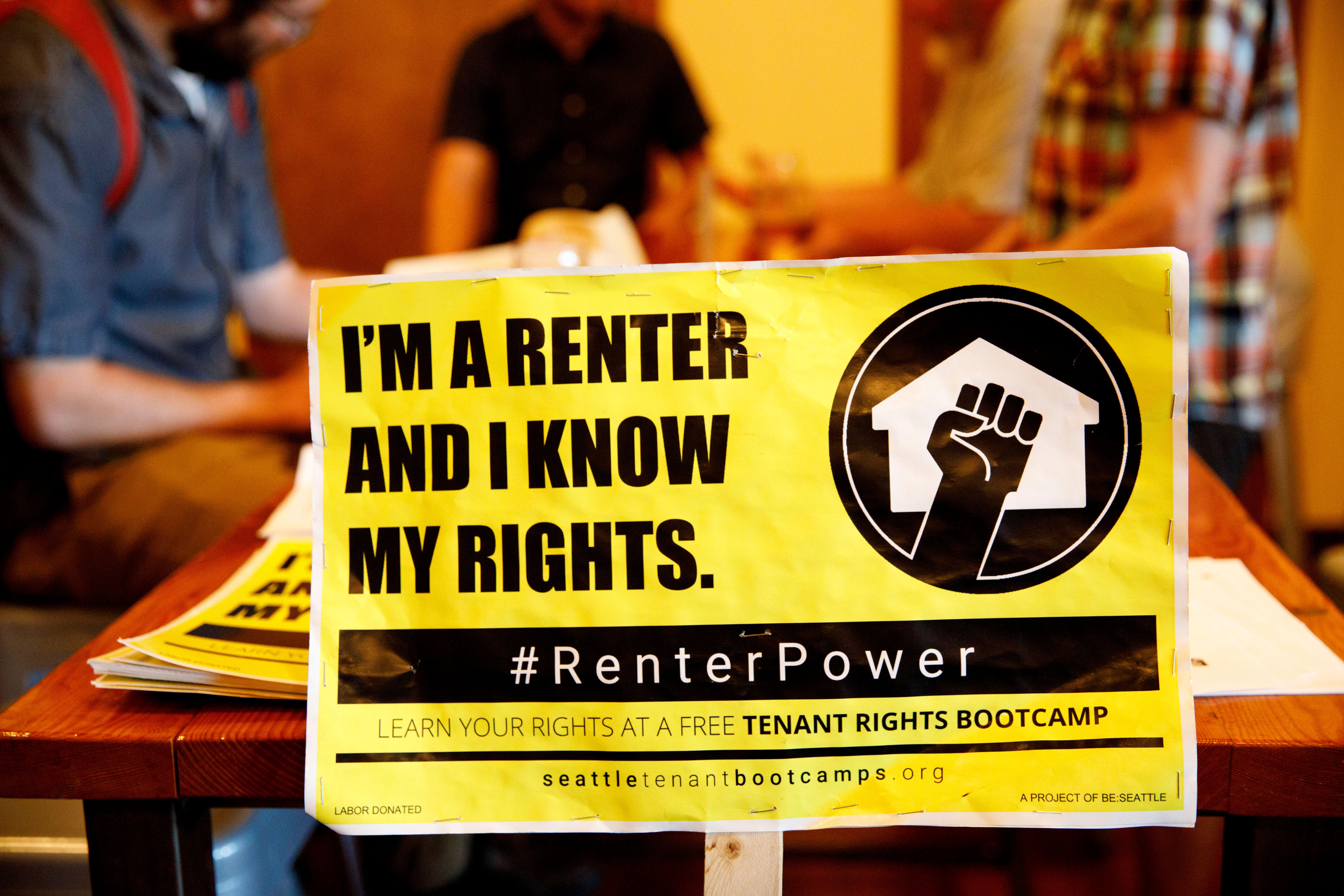 A sign rests on the table during a Tenant Rights Bootcamp on Wednesday, July 25, 2018 at Schilling Cider House in Fremont, Seattle, WA. The event was hosted by Be:Seattle and provided information on Seattle tenants rights. (Sarah Hoffman/Crosscut)