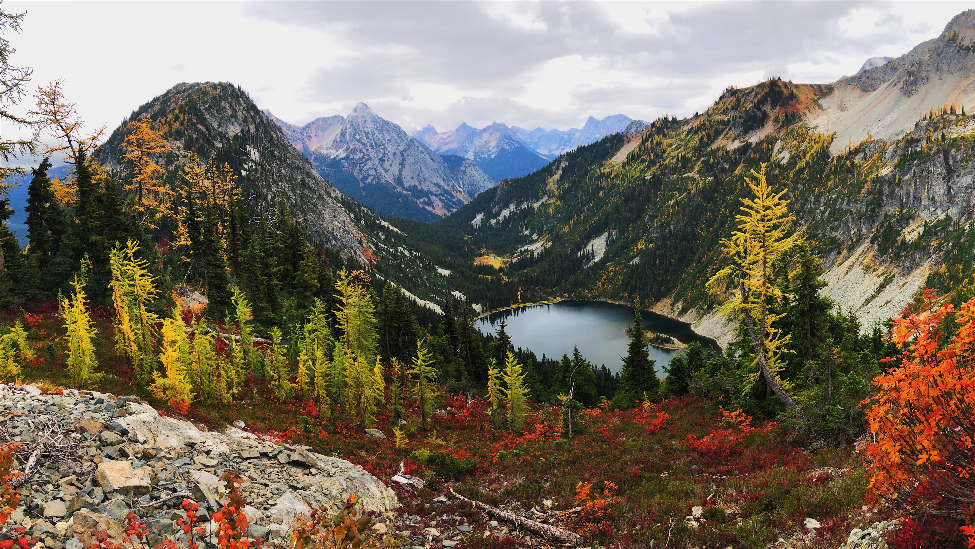 Cascade peak, alpine lake, and fall foliage at Maple Pass in the North Cascades