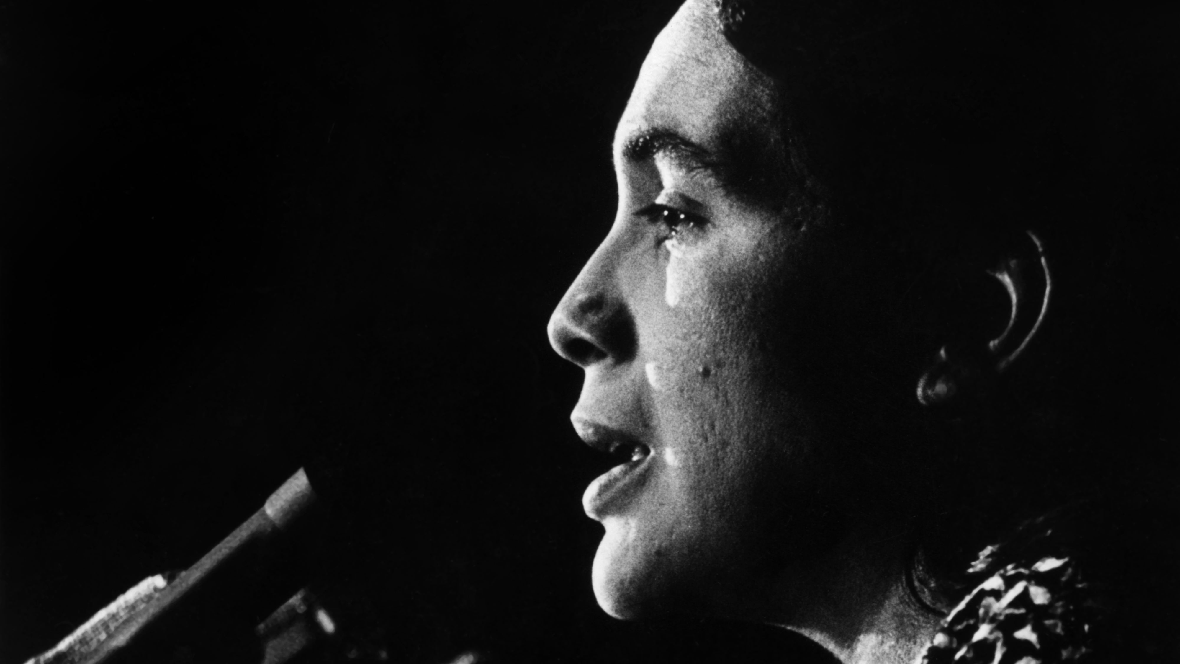 #4 - Dolores Huerta speaks at the podium. c1970s. Courtesy of Walter P. Reuther Library Archives of Labor and Urban Affairs Wayne State University