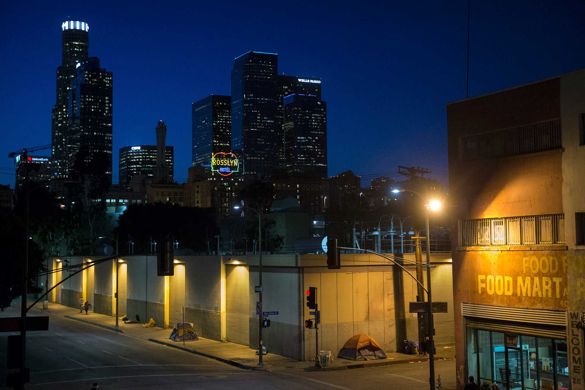 In this April 25, 2016, file photo, homeless people sleep in the Skid Row area of downtown Los Angeles. (AP Photo/Jae C. Hong, File)