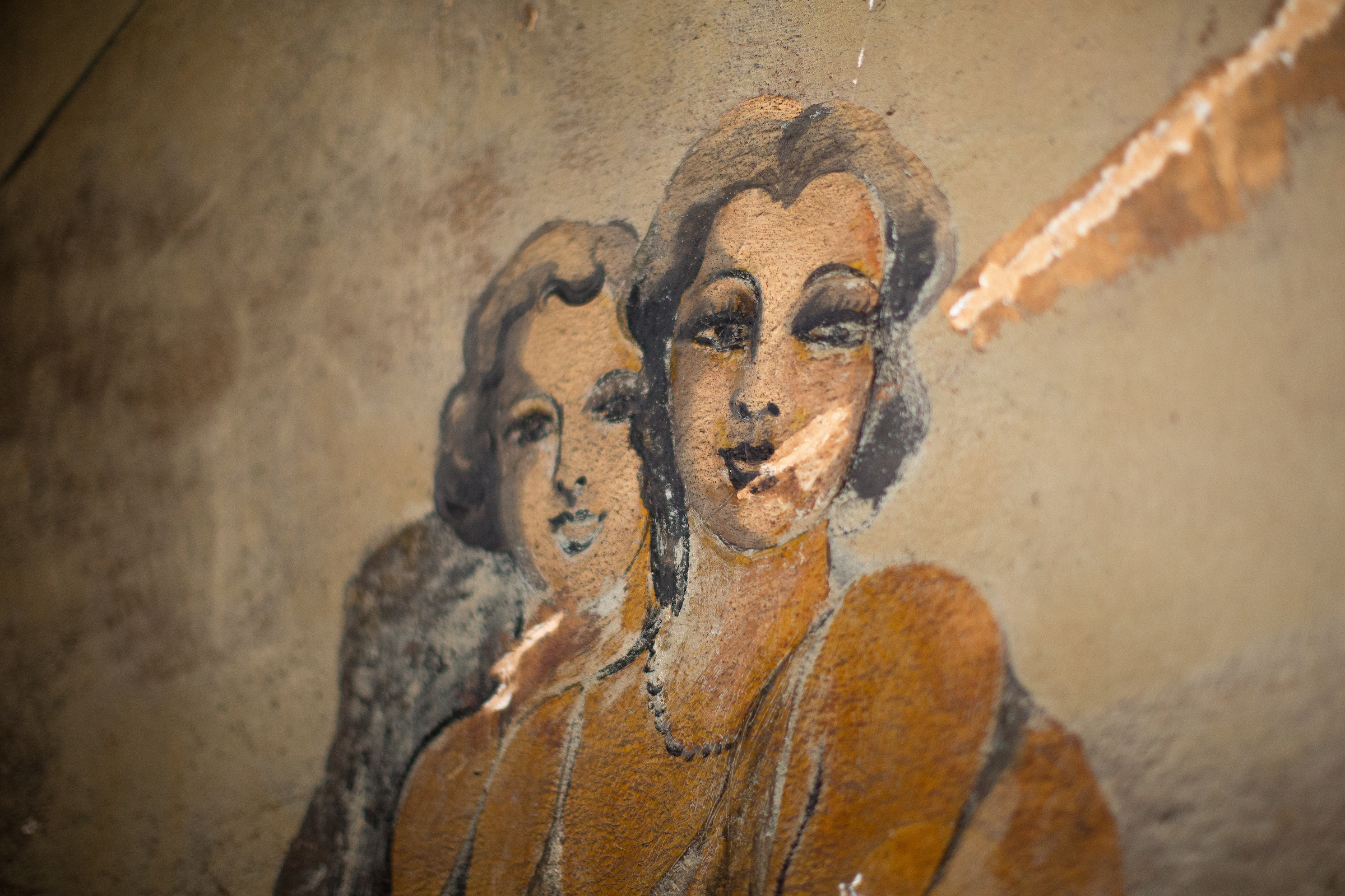 A painting of two women found on the walls inside the Louisa Hotel in Seattle