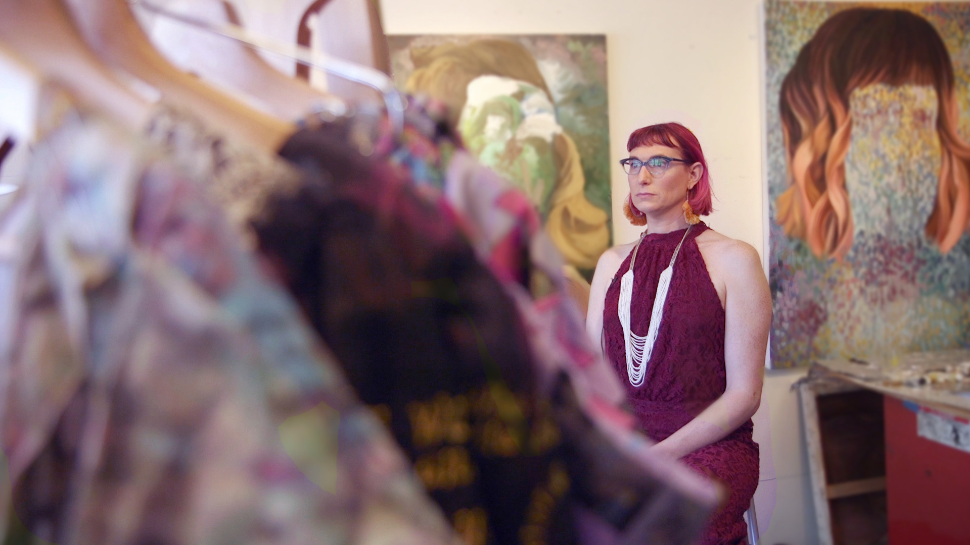 Seattle artist Jono Vaughan in her studio with dresses created for Project 42.