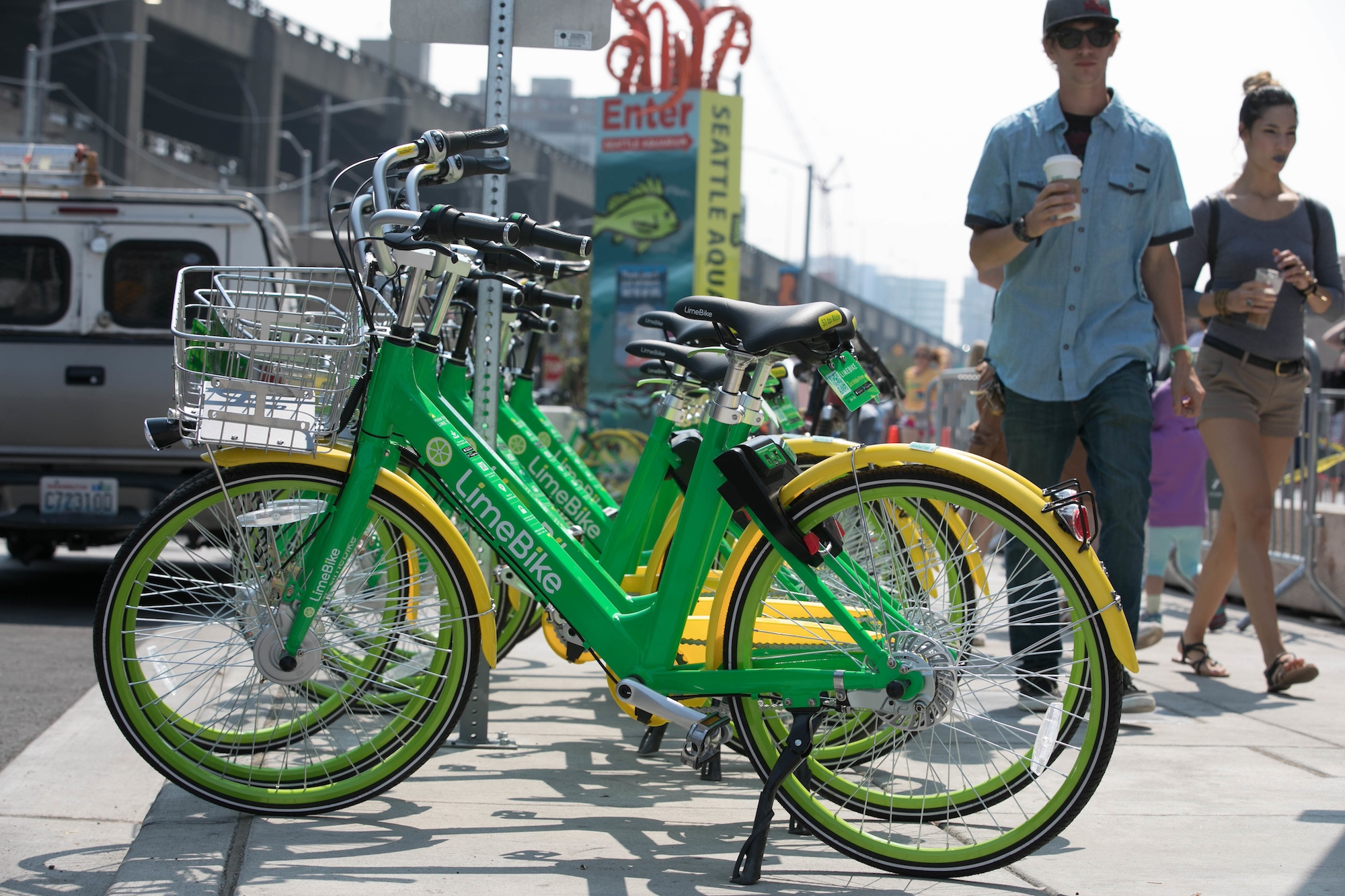 LimeBike bikeshare bicycles along Alaskan Way waterfront in downtown Seattle, Washington on Tuesday, August 8, 2017.