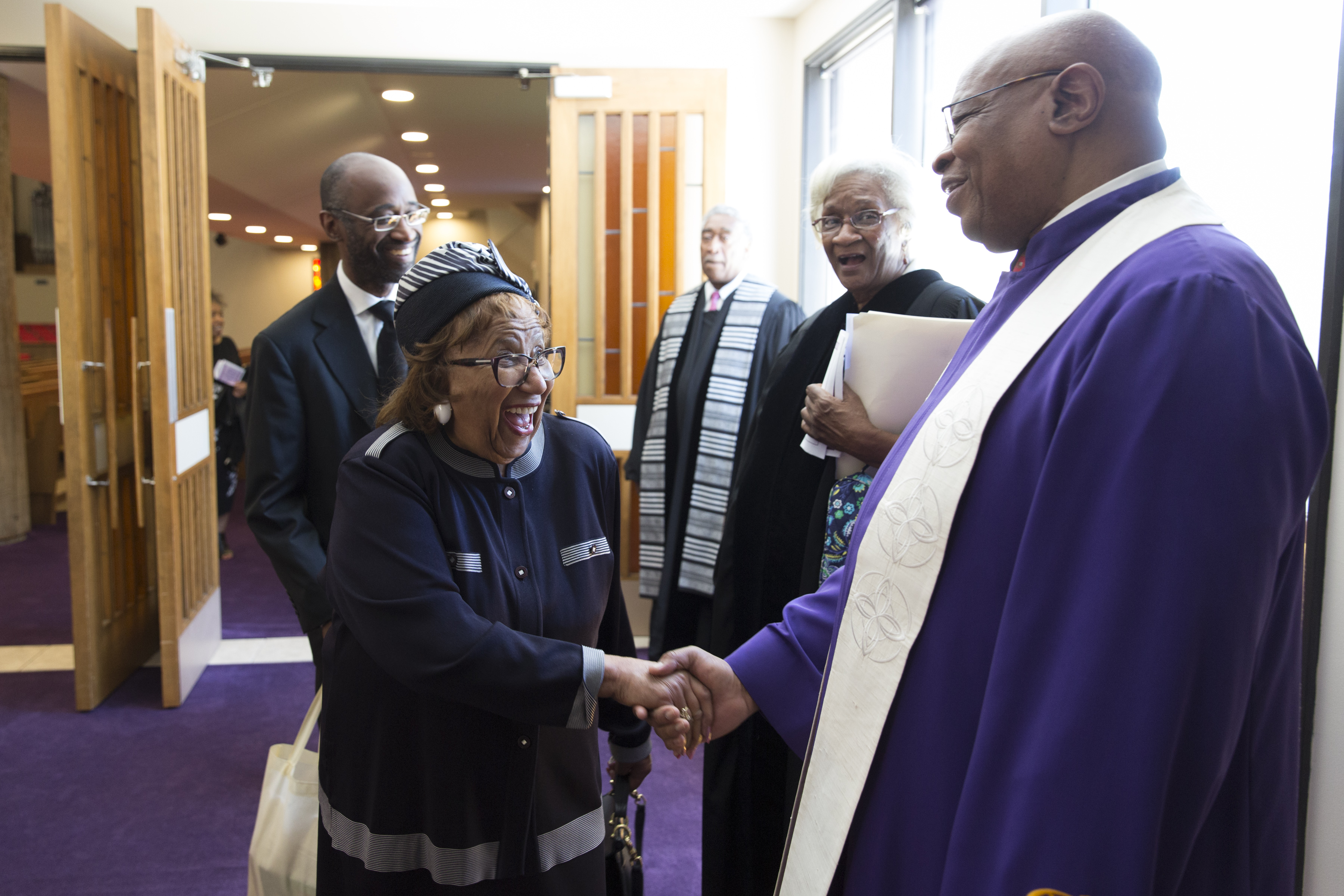 Rev. James Stallings shakes hands with a member of Mount Zion Baptist Church on Sunday, May 27, 2018.