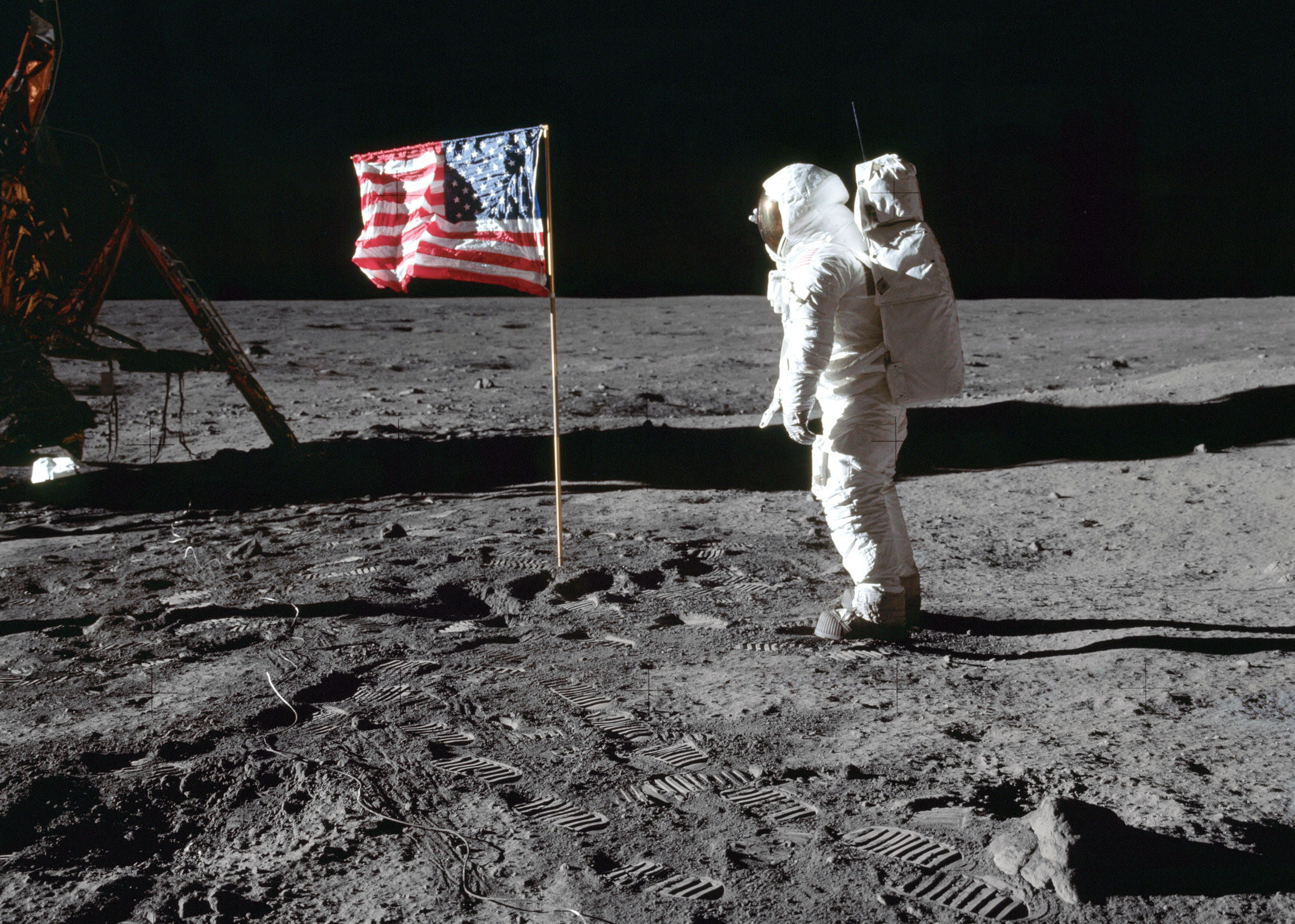 Astronaut Edwin E. Aldrin Jr., lunar module pilot of the first lunar landing mission, poses for a photograph beside the deployed United States flag during an Apollo 11 extravehicular activity (EVA) on the lunar surface, July 20, 1969. (Photo by Neil A. Armstrong via NASA)