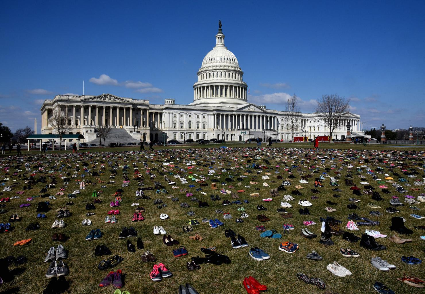 Thousands of children's shoes line the grounds of the Capitol building in D.C.