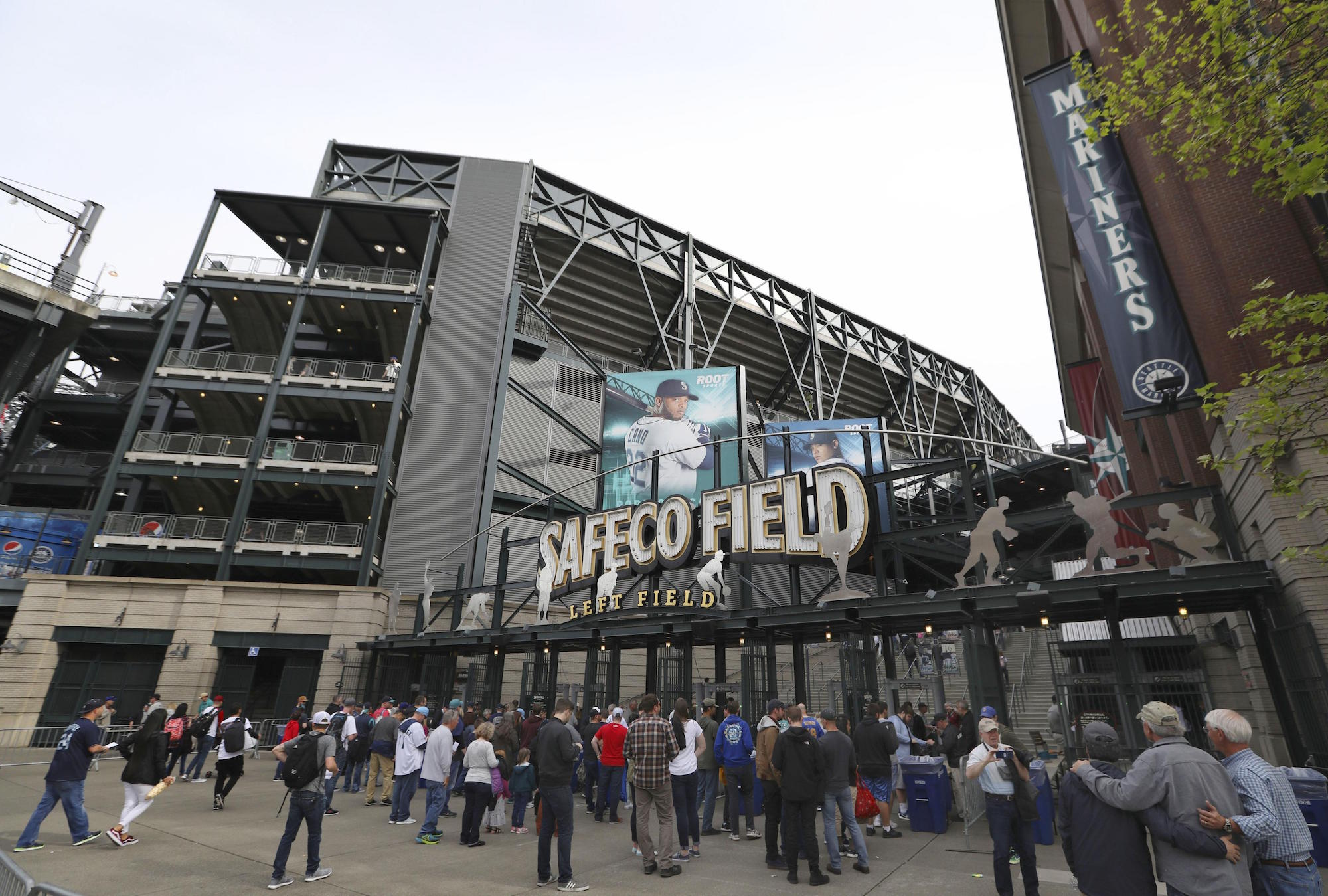 A crowd enters Safeco Field, the home stadium of the Seattle Mariners baseball club, on May 5, 2018. (Photo by Kyodo/via AP Images)