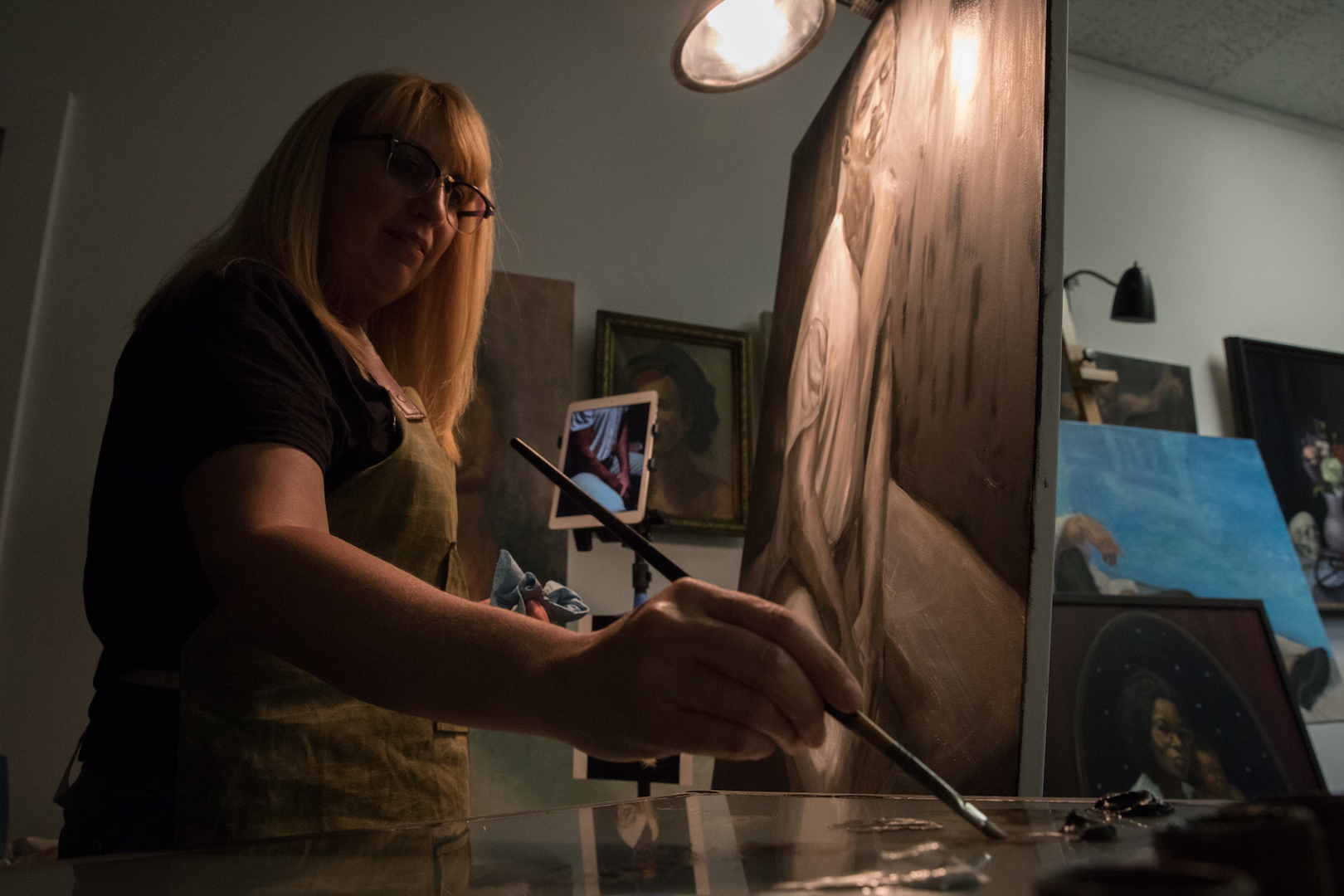 Andrea Gahl painting a portrait in her Sodo studio