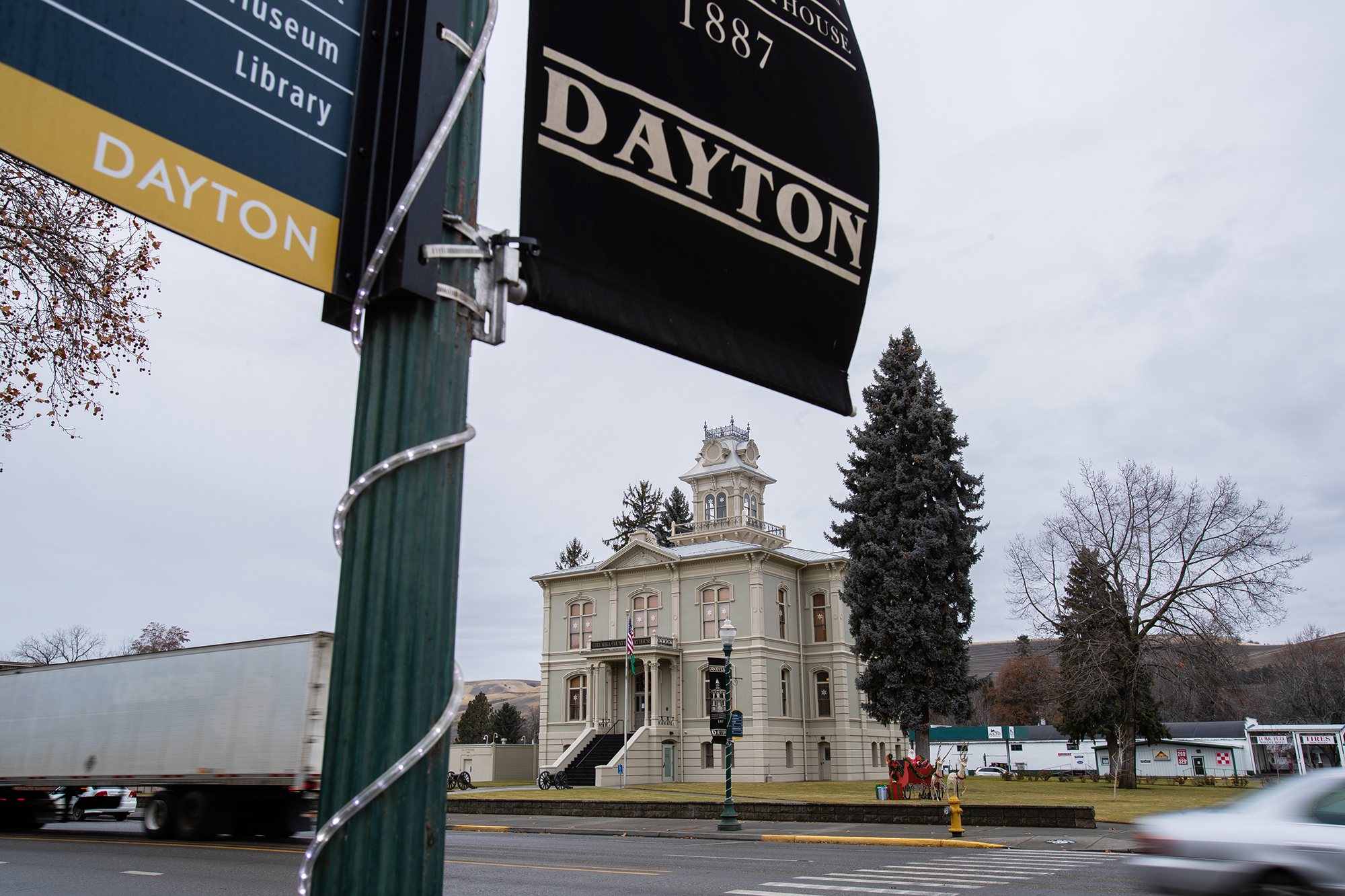 A Dayton city flag flies in front of the Columbia County courthouse
