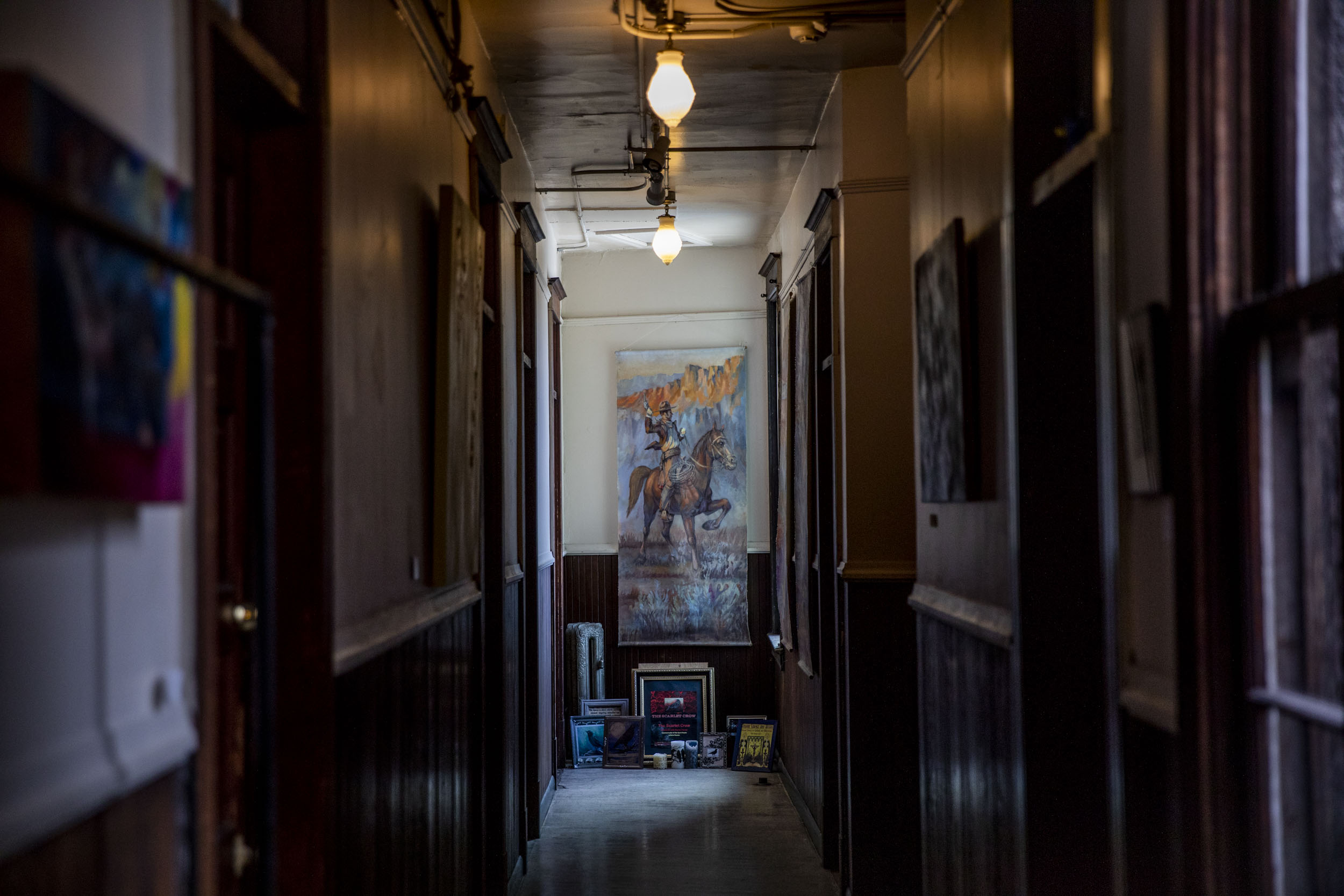 A hallway of apartments that John Bennett owns in the Georgetown neighborhood of Seattle on May 8, 2019. (Photo by Dorothy Edwards/Crosscut)