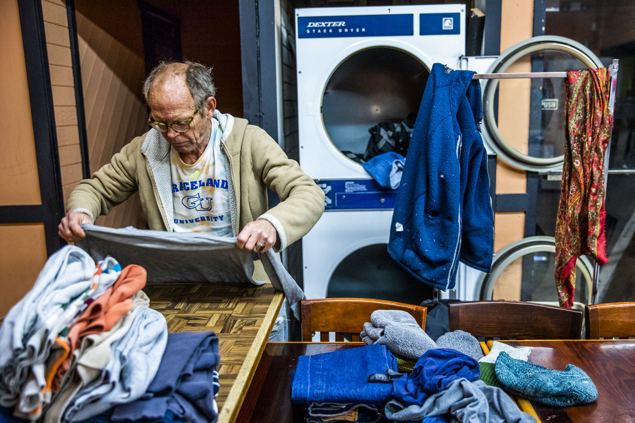 Alan Sutherland, 64, of Seattle does his laundry at King Donuts in Rainier Beach on Sunday, Nov. 18, 2018. Sutherland says he comes every Sunday to do his laundry at King Donuts.