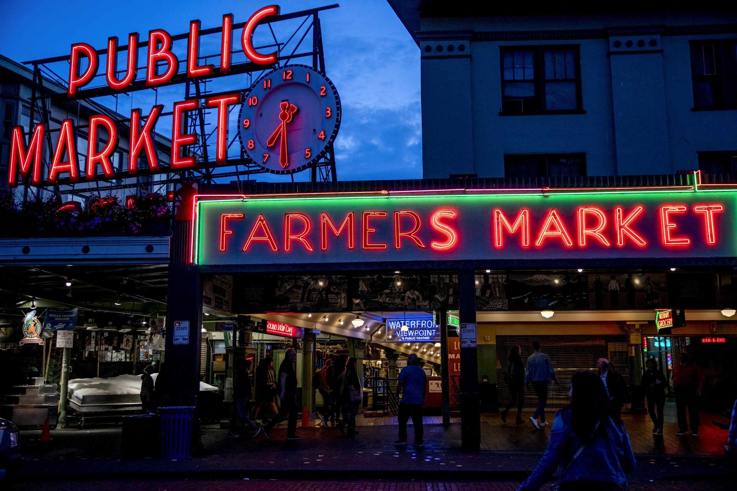 Pike Place Market sign aglow at night