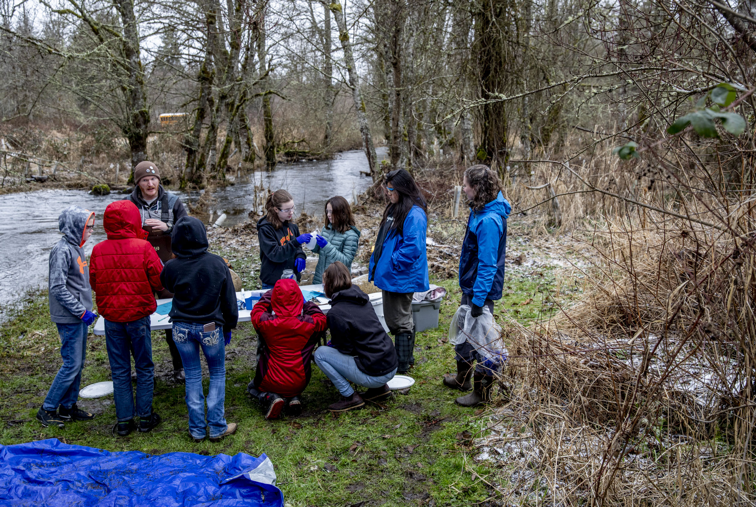 Members of Cougar Mountain Middle School's Science Squad test the water quality of Muck Creek.