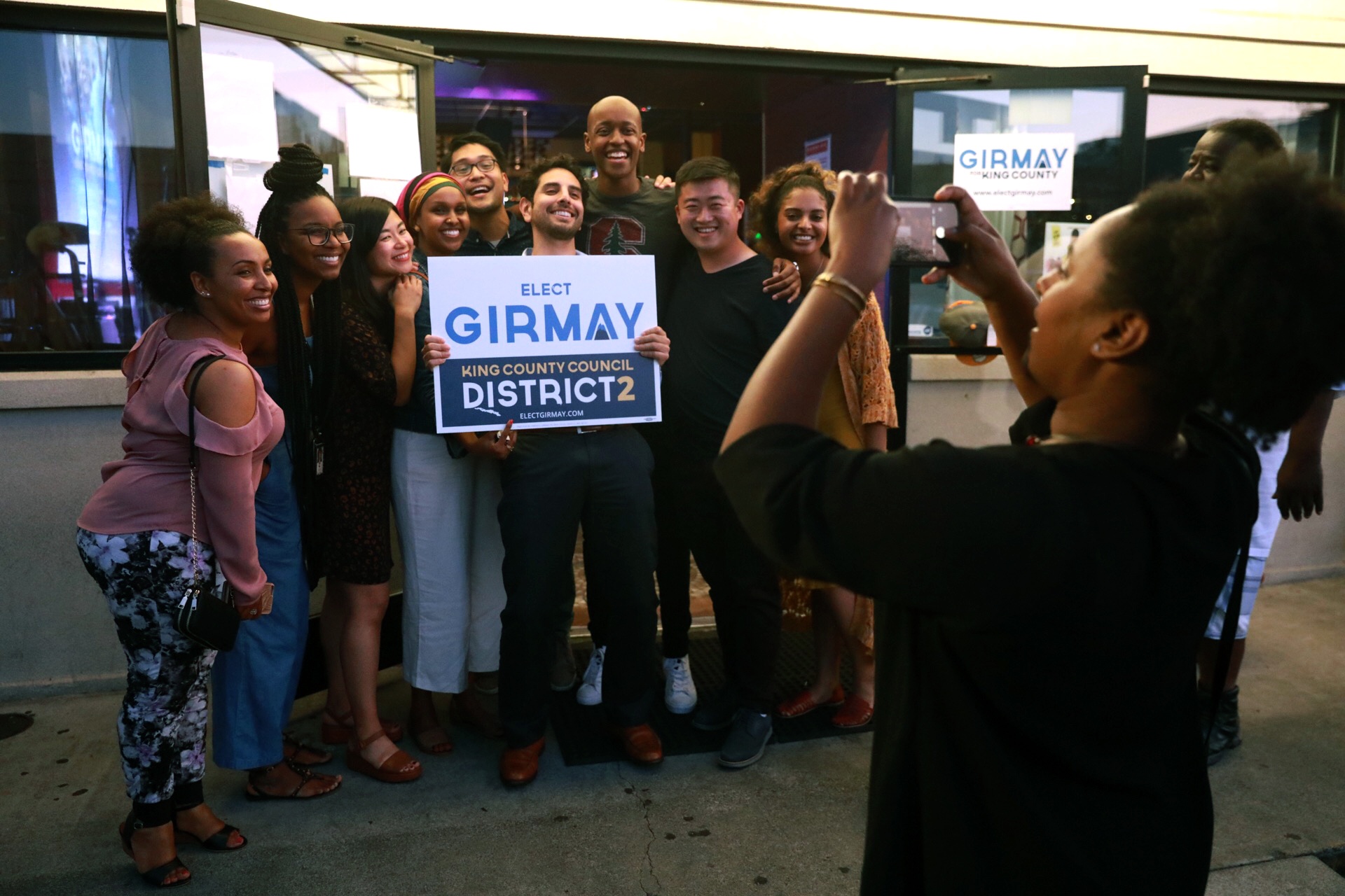 Girmay Zahilay poses with supporters.