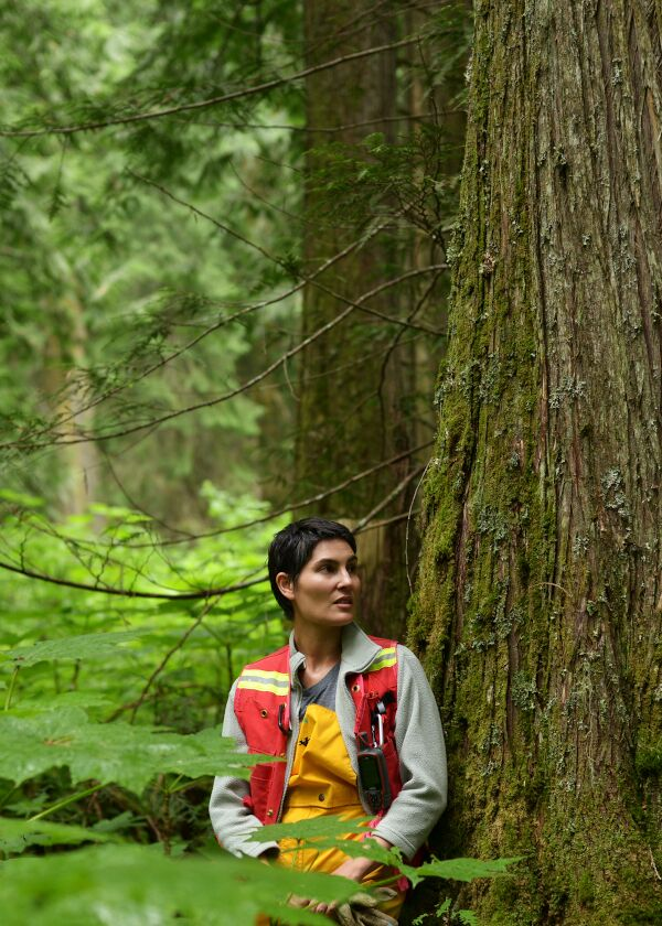 Michelle Connolly of Conservation North stands in a forest