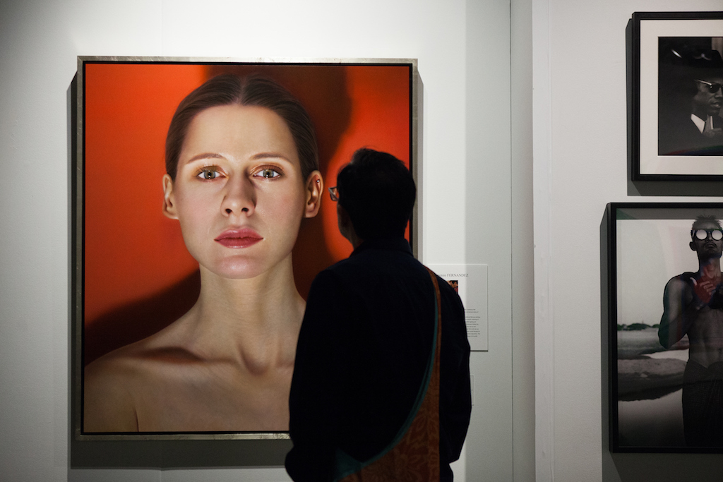 Seattle Art Fair attendee views Spanish painter Lorenzo Fernandez