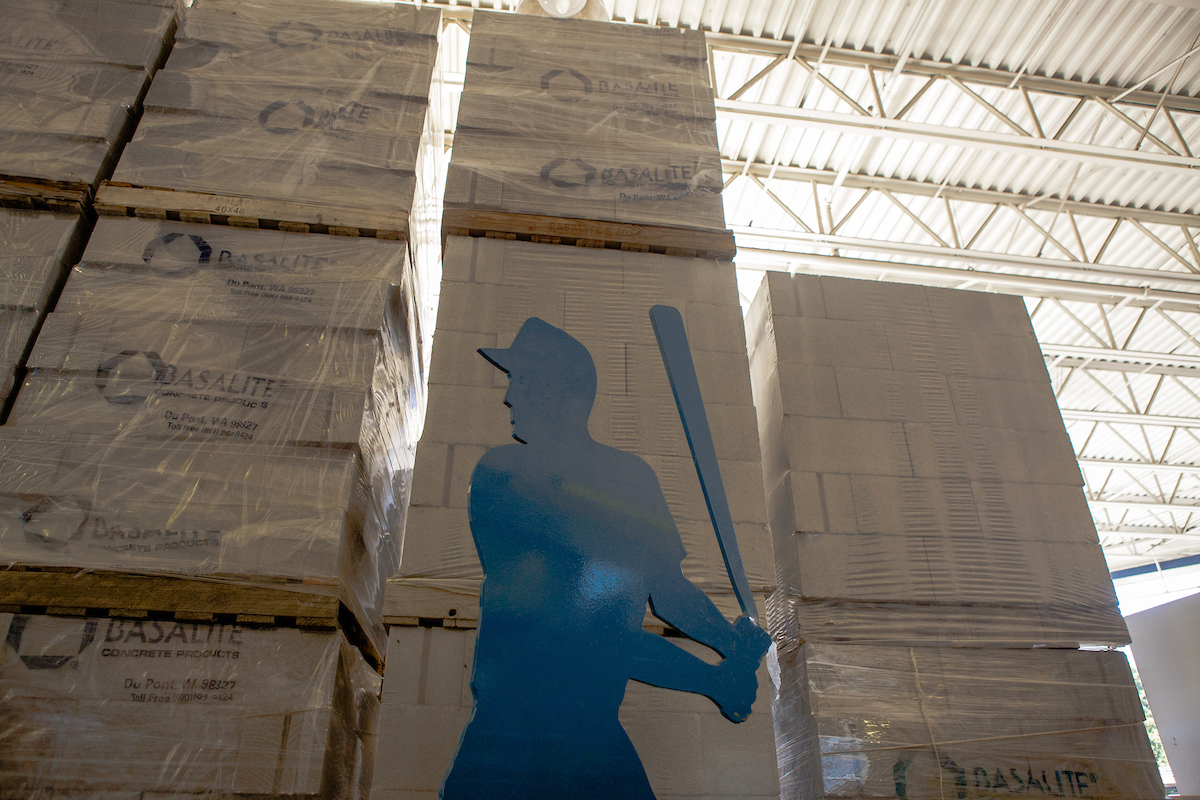 a statue of a baseball player inside the Lowe's Hardware store
