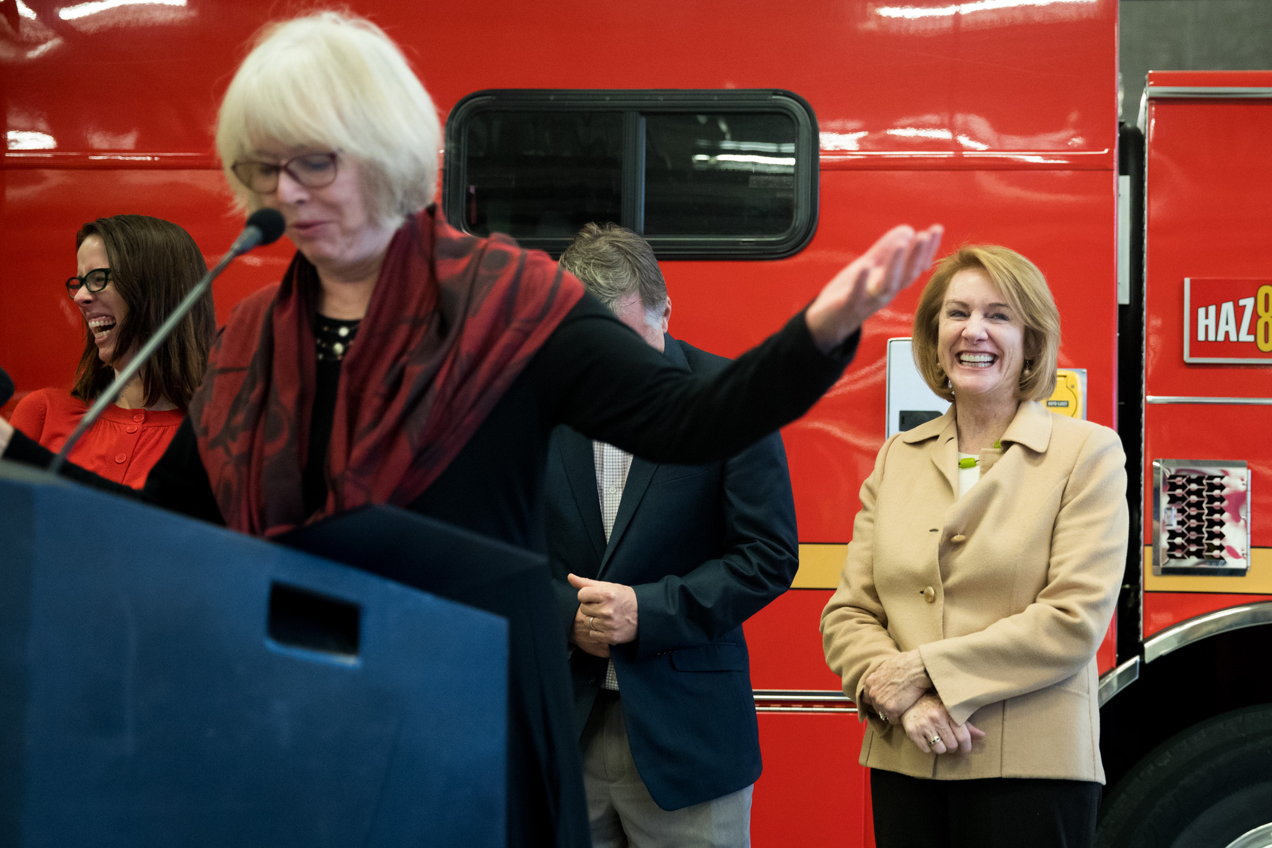 Mayor Jenny Durkan listens to Seattle City Councilmember Sally Bagshaw speak during a city budget signing ceremony at Fire Station 10 in Seattle, Nov. 26, 2018.