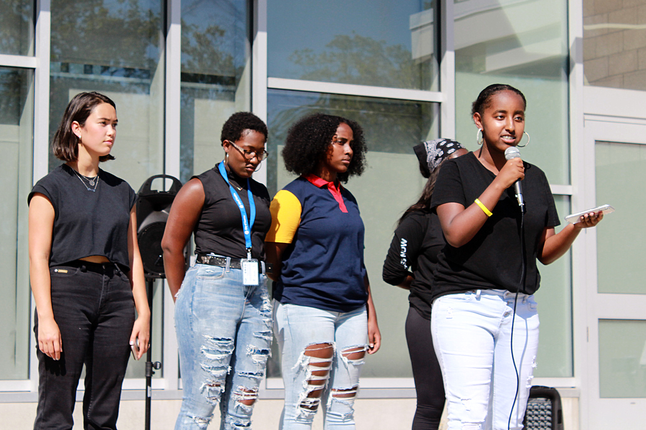 Students from Seattle Public Schools and student allies from other districts speak at a rally at the Rainier Beach Community Center on September 4. Pictured from left to right: Davie Ross, Angelina Riley, Kidist Habte and Betty Mekonnen.