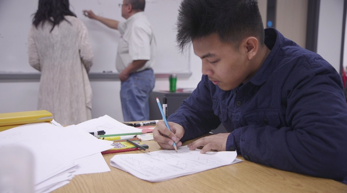 Joshua Villanueva arrives hours earlier than most of his peers for math tutoring. He is looking forward to graduation from Seattle World School next year.
