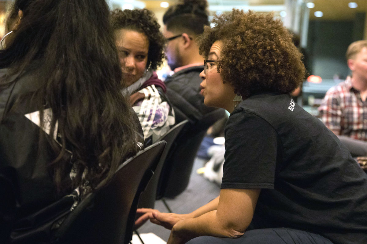 Harris-Talley sits with former mayoral candidate Nikkita Oliver and throngs of other activists in the Bertha Knight Landes room of Seattle City Hall.
