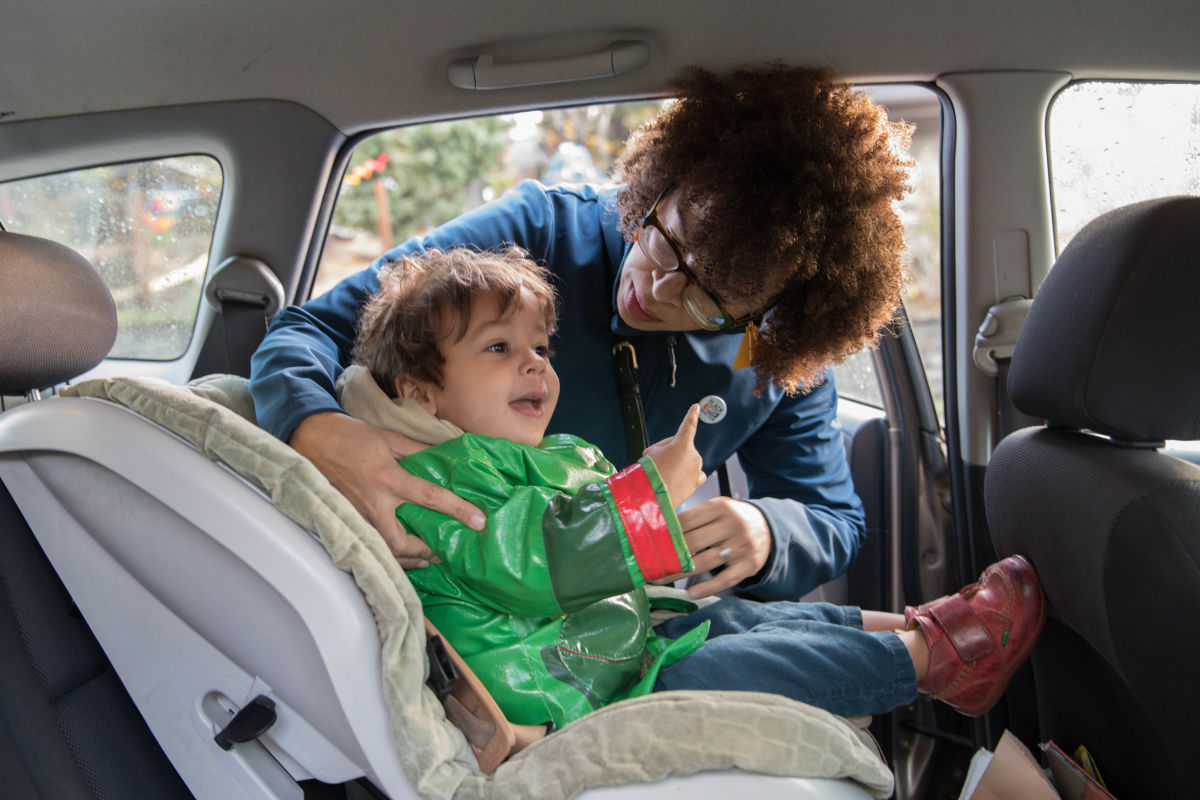 Harris-Talley loads her son Malcolm, 2, into the family car as she prepared to take her daughter Cora to elementary school in Columbia City.