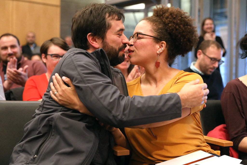 As the City Council announces Harris-Talley has been appointed to the interim at-large Position 8 seat, her husband Jason leans in to give her a congratulatory kiss.