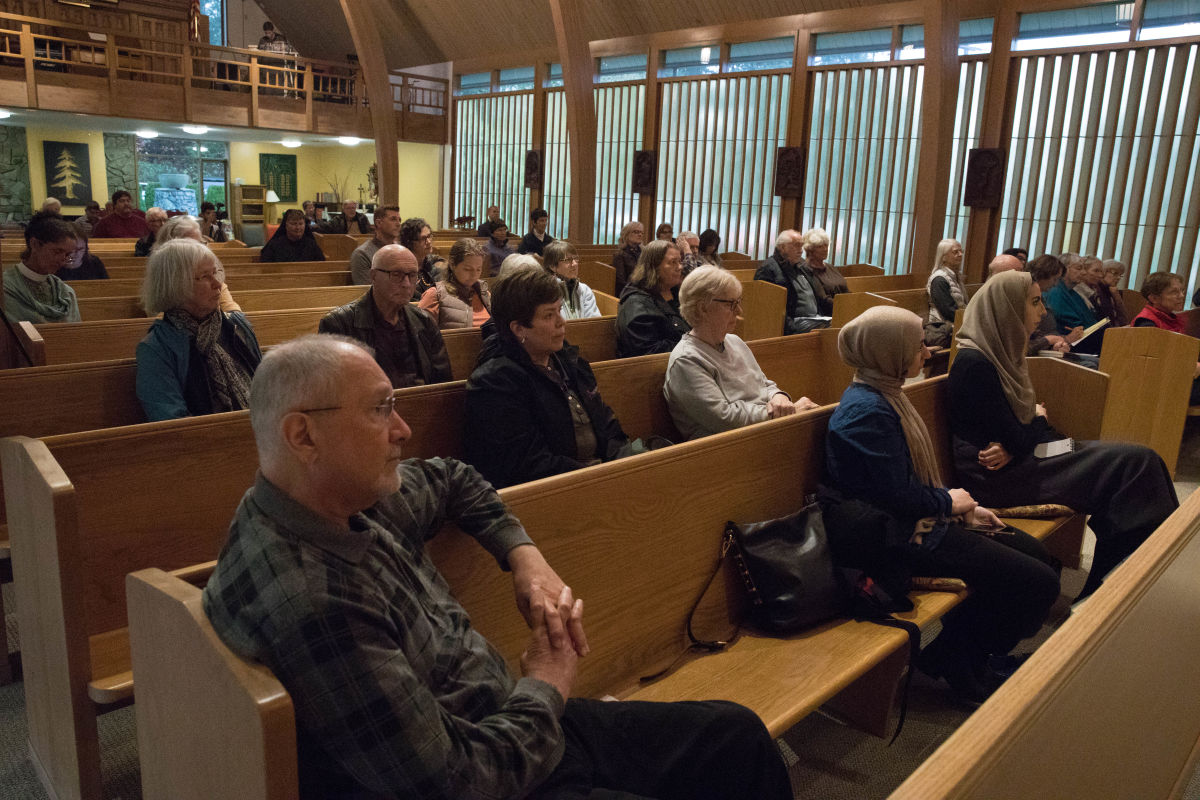 Church visitors listen to Aneelah Afzali and Terry Kyllo speak at St. Paul's Episcopal Church in Mt. Vernon.