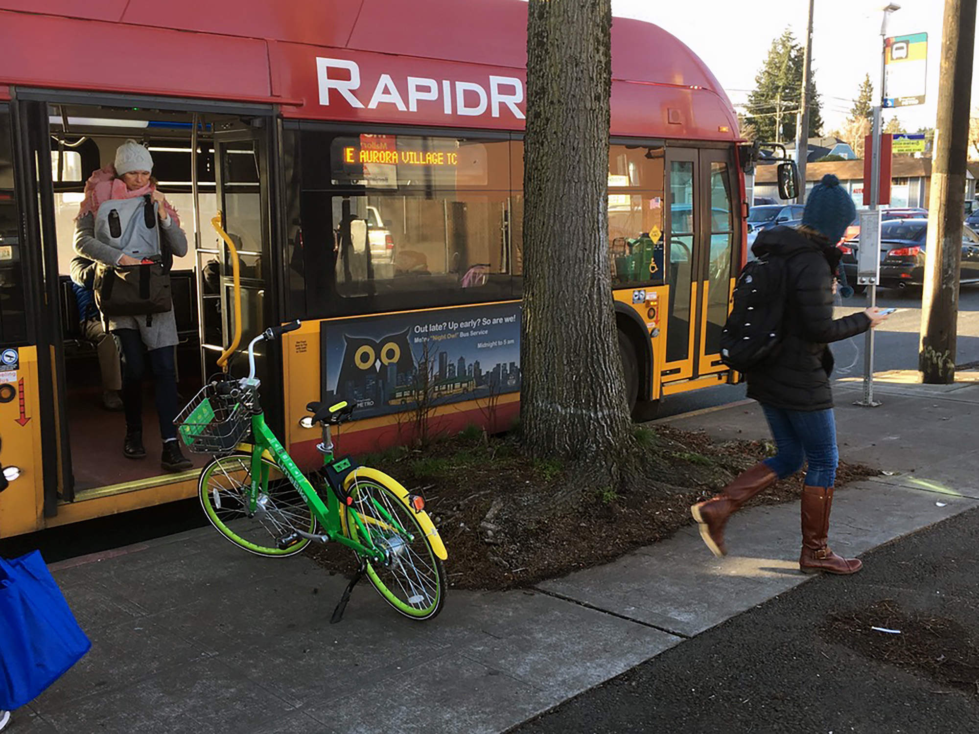 A rental bike directly interferes with a transit rider as she turns into a pedestrian (Photo by Douglas MacDonald)