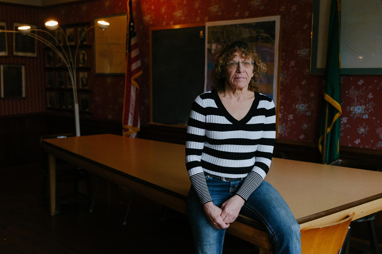 Mayor Carla Vandive sitting on a pool table