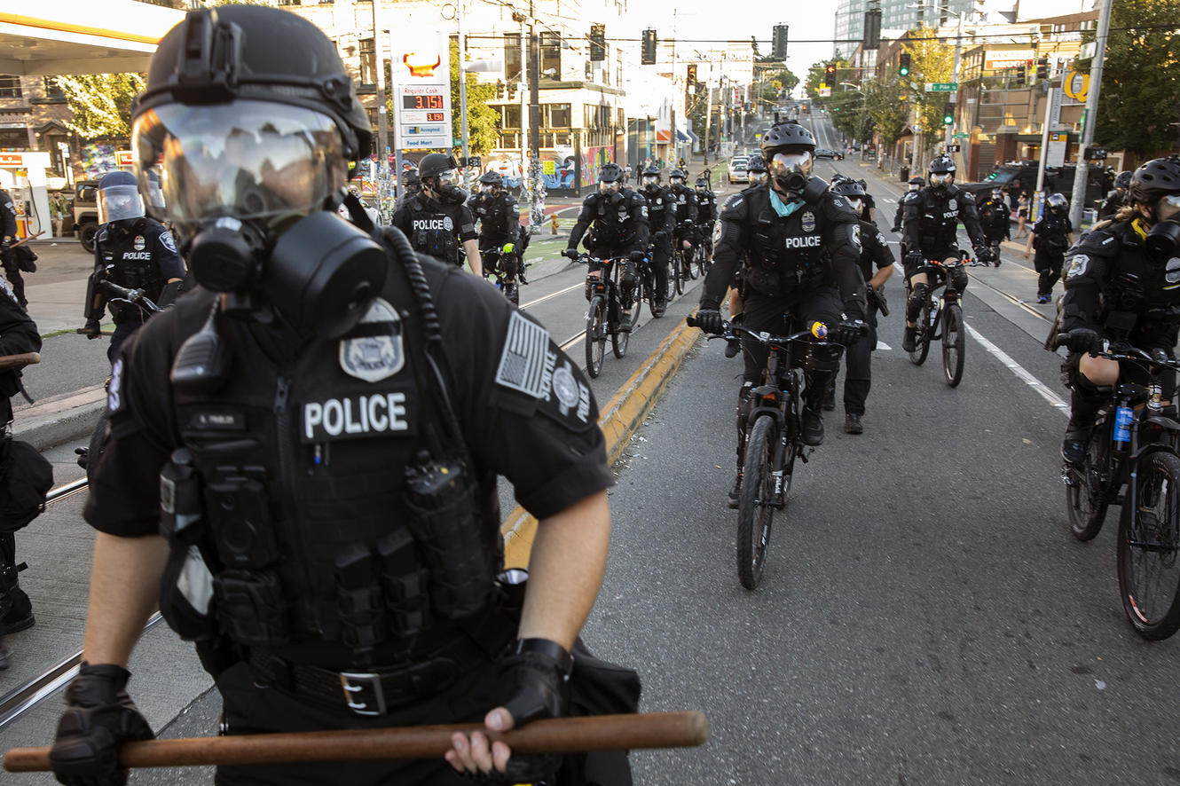 Members of the Seattle Police Department make their way to respond to protests in Seattle.