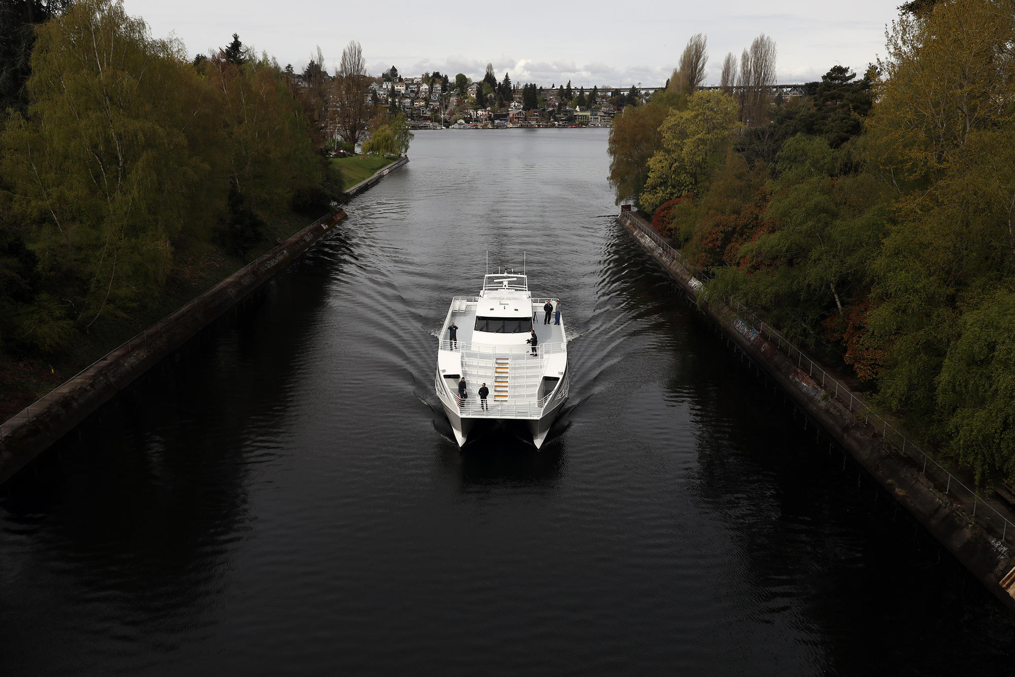 The Saratoga is seen passing through the Montlake Cut from the Montlake Bridge during a water taxi test ride from Lake Union Park at South Lake Union in Seattle to Southport on Lake Washington in Renton, during the morning of April 18.