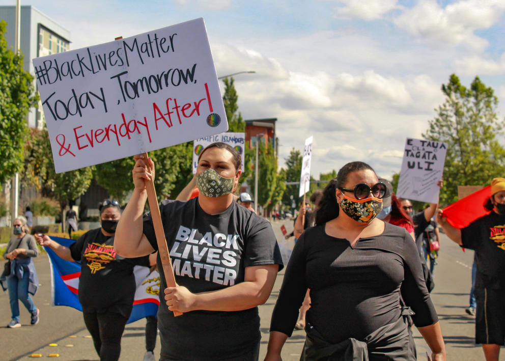Tepatasi Vaina, left, marches with Donato Fatuesi at a Black Lives Matter march in Kent, June 11, 2020. Vaina and Fatuesi are, respectively, the community engagement manager and operations manager of United Territories of Pacific Islanders Alliance, an advocacy group for sex workers in the state. (UTOPIA Seattle)