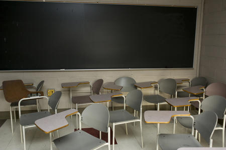 Empty chairs and desks inside a classroom