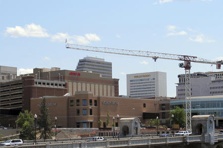 The Spokane city skyline with a construction crane in the foreground.
