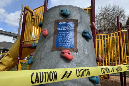 A playground shut down with caution tape