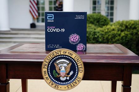 coronavirus test kit behind the presidential seal